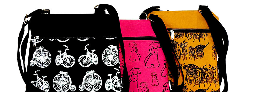 Kolme laukku, pyörät, koirat ja ylämaankarjaa